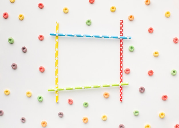 Colorful frame with straws and cereal