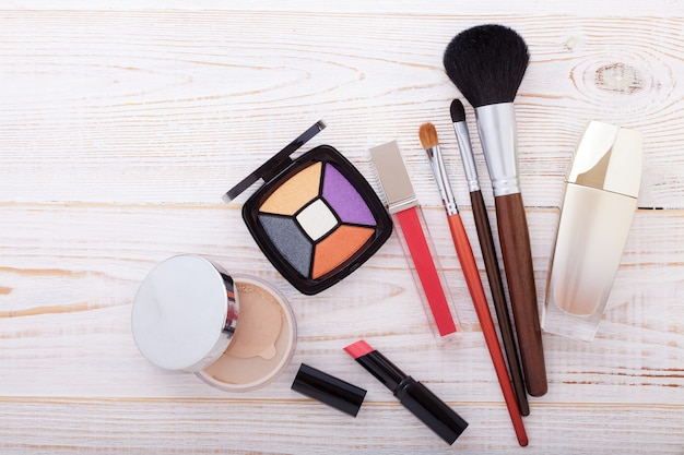 Colorful frame with various makeup products