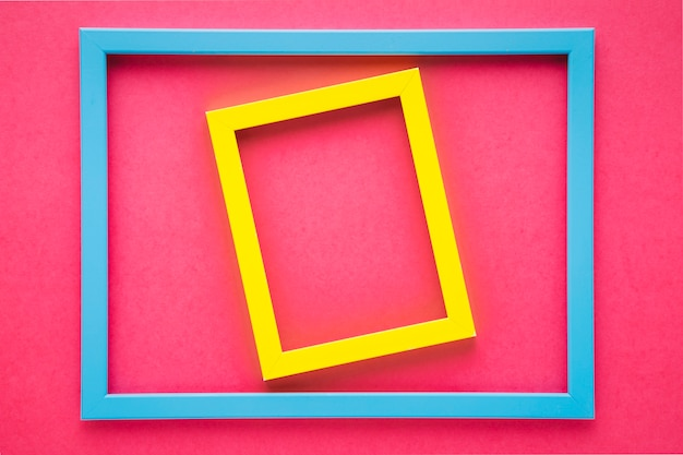 Colorful frames on pink background