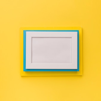 Colorful frames on yellow background