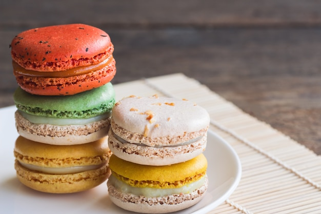 Colorful french macaron or italian macaron stack on white plate. homemade delicious macaro