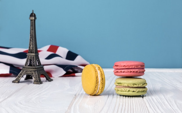 Colorful french macaron with eiffel tower in background