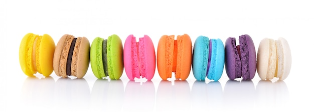 Colorful french macarons on white wall