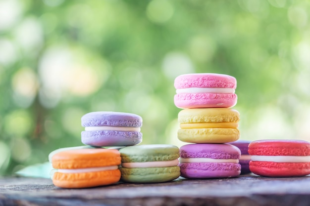Colorful french macarons on wooden table