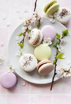 Colorful french macaroons on tile background
