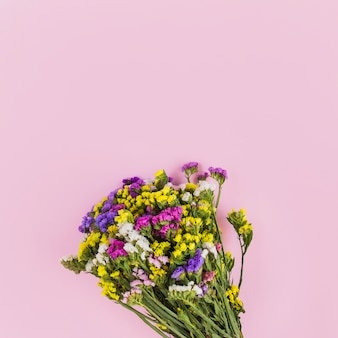 Colorful fresh flower bouquet on pink background