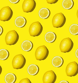 Colorful fruit pattern of fresh lemon and lemon slices on colored background. lemon slices top view, flat lay