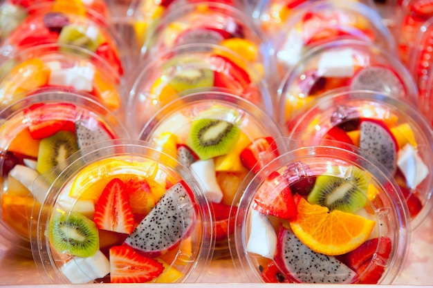 Colorful fruit salad in transparent glasses