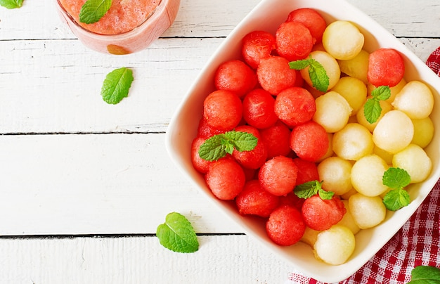 Colorful fruit salad. watermelon and melon salad. fresh summer food. top view