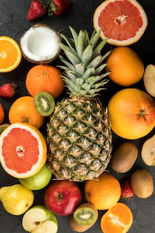 Colorful fruits vitamine riched yummy mellow juicy isolated on a dark floor