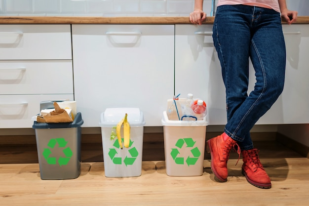 Colorful garbage bins filled with plastic, bio food, paper