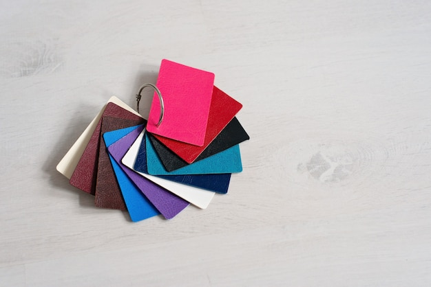 Colorful genuine leather fashion samples, modern shops, industry concept. palette catalog with color leather samples.