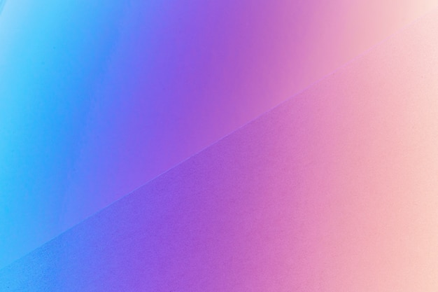 Colorful geometric paper background in neon light, copy space