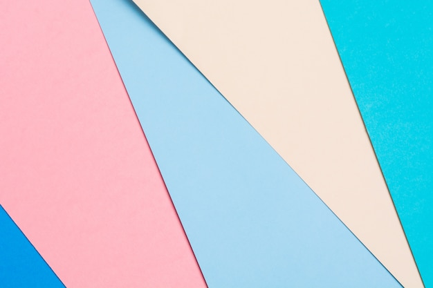 Colorful geometric paper background. origami concept of five paper colors