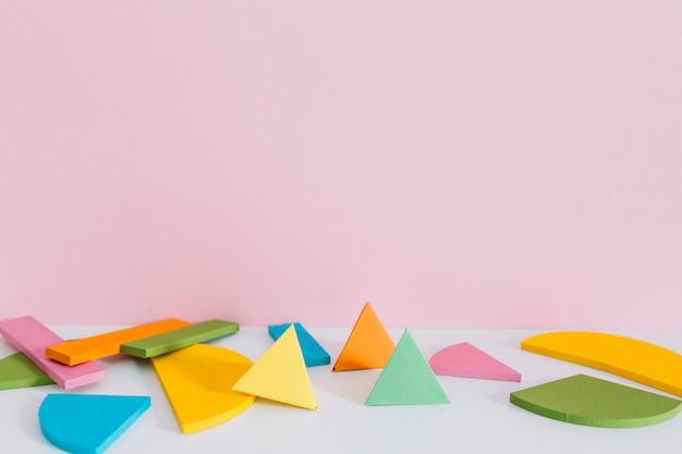Colorful geometric shapes against pink background
