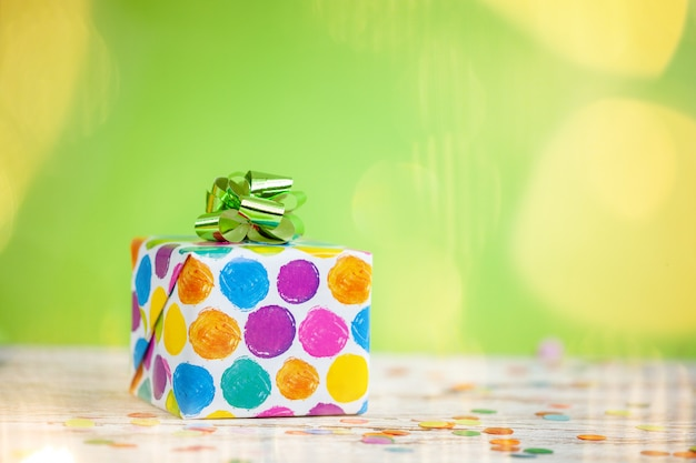Colorful gift box on lime color background. holiday greeting card
