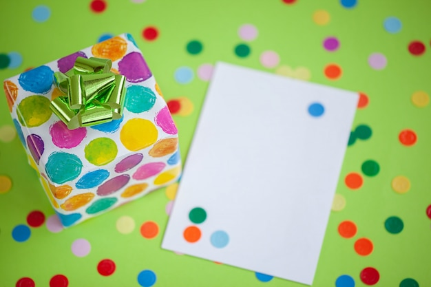 Colorful gift box with empty blank on lime color background. holiday greeting card.
