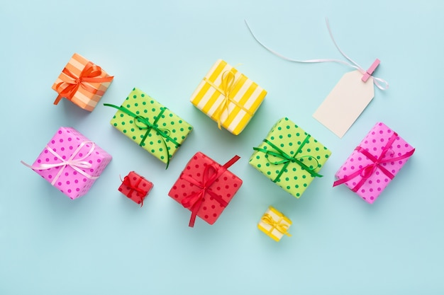 Colorful gift boxes and blank gift tag