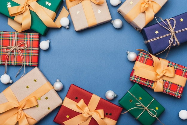 Colorful gift boxes for christmas with globes