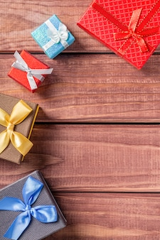 Colorful gift boxes on dark wood background