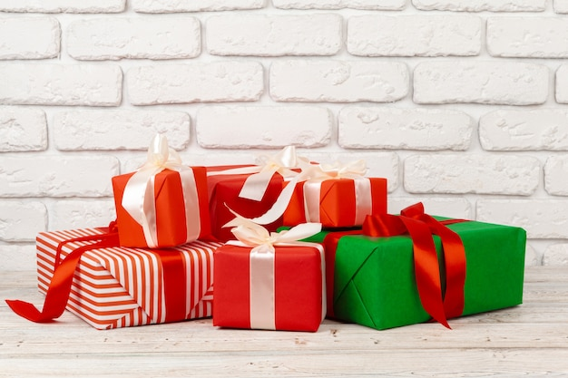 Colorful gift boxes with white brick wall