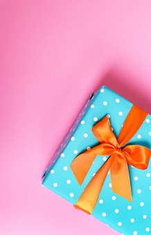 Colorful gift on a pink background