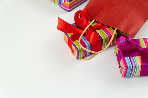 Colorful gifts coming out of paper bag