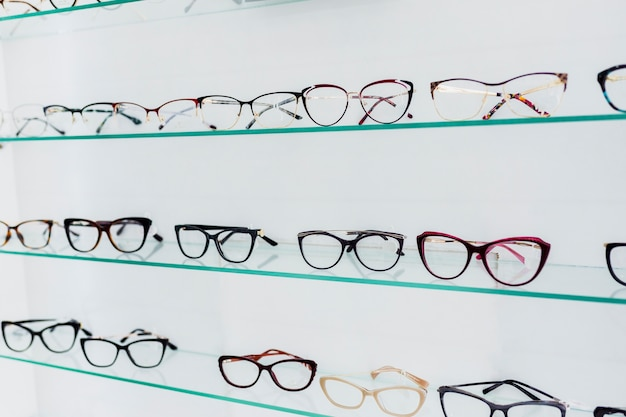 Colorful glasses frames on display in shop