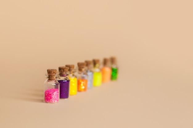 Colorful glitter in bottles