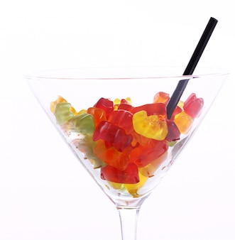 Colorful gummy bear candies in the glass
