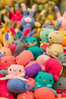 Colorful handmade knitted small toys for children, background