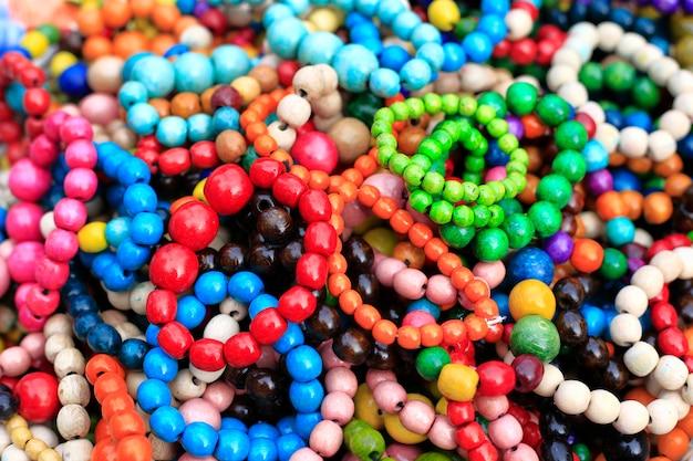 Colorful handmade wooden bracelets, close-up background