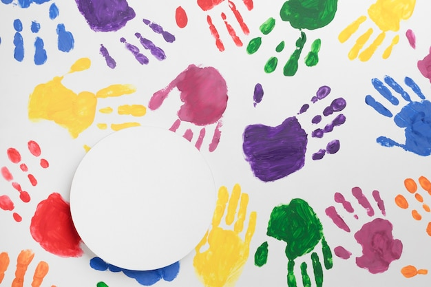 Colorful hands background with white circle