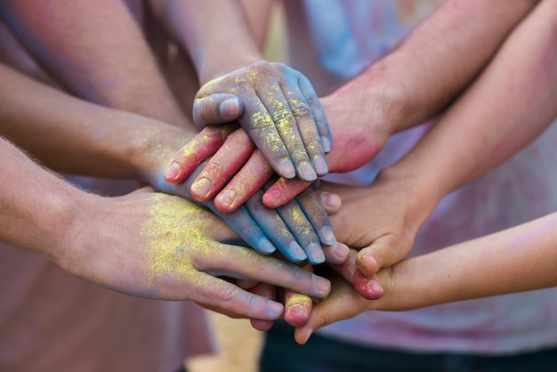 Colorful hands at festival close-up