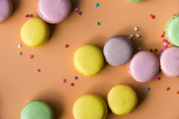 Colorful heart shape sprinkles with macaroons