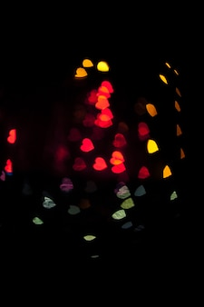 Colorful hearts on black background