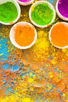 Colorful holi powders in buckets