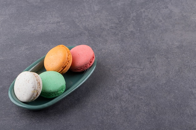 Colorful homemade cookies on grey plate