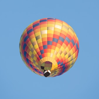 Colorful hot air balloon on the blue sky