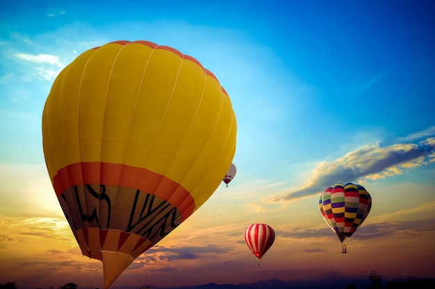 Colorful hot air balloon flying on sky at sunset. travel and air transportation concept. balloon carnival in thailand