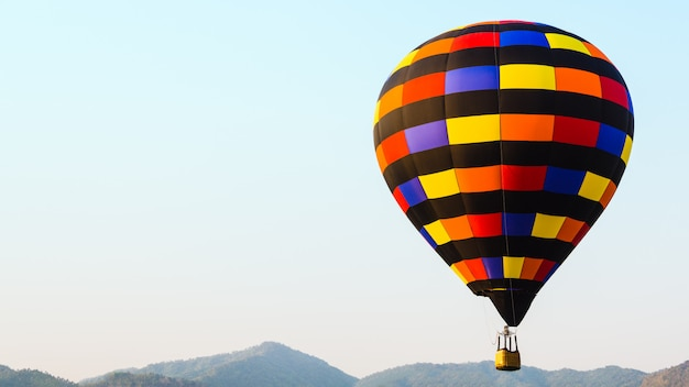 Colorful hot air balloon with sky and mountain background