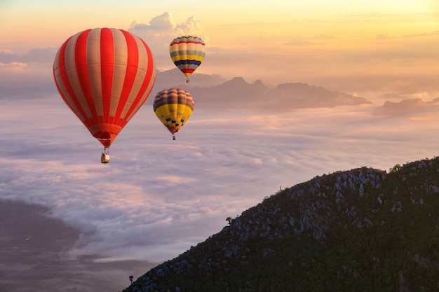 Colorful hot-air balloons flying over the doi luang chiang dao