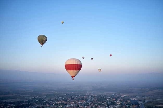 Colorful hot air balloons flying in the morning sky