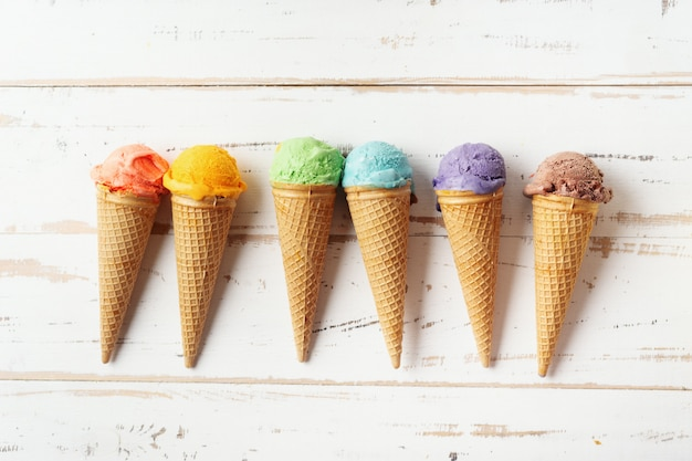 Colorful ice cream cones on white backgound