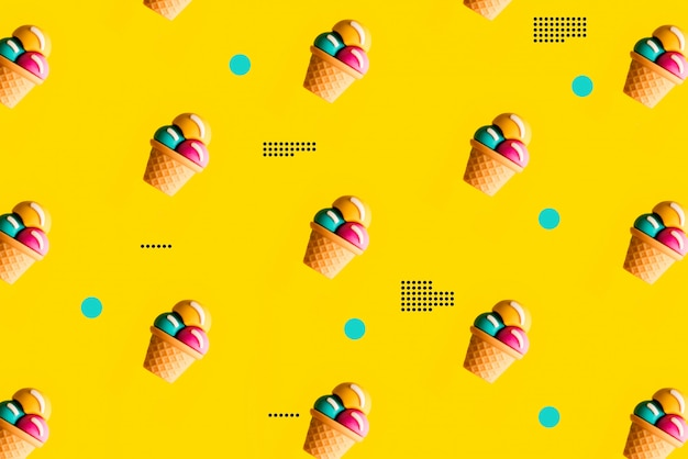 Colorful ice cream pattern on yellow background.