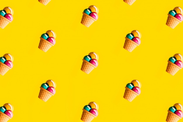 Colorful ice cream pattern on yellow