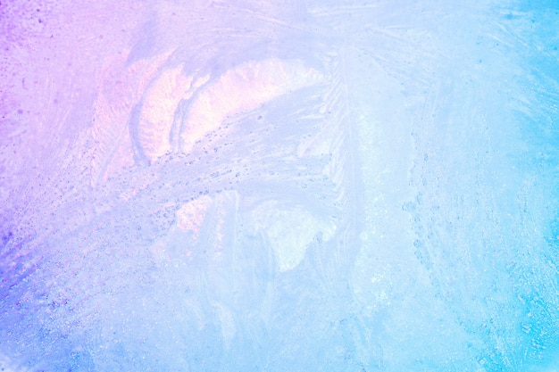 Colorful ice texture background. iridescent holographic bright colors of winter or ice for summer drinks