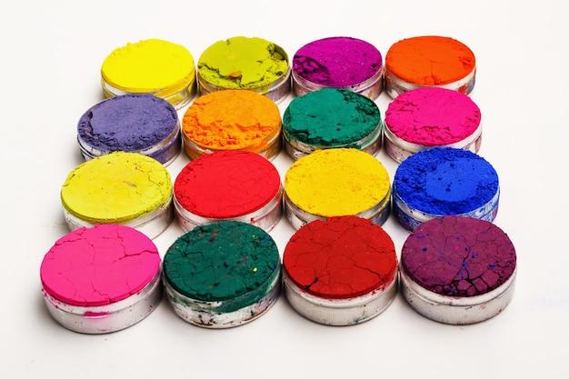 Colorful indian holi festival dyes on white background