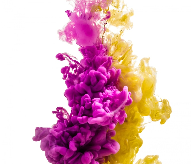 Colorful ink isolated on white. pink yellow  drop swirling under water. cloud of ink in water.