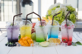Colorful italian soda arranged on wood table